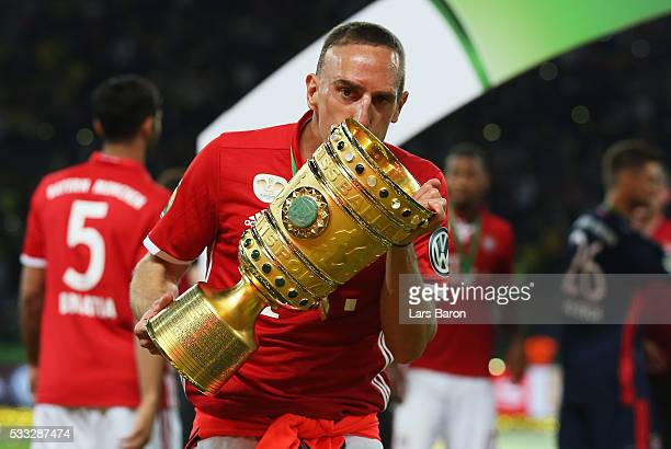 Franck Ribery of Bayern Muenchen kisses the trophy after winning the DFB Cup Final in a penalty shootout against Borussia Dortmund at Olympiastadion...