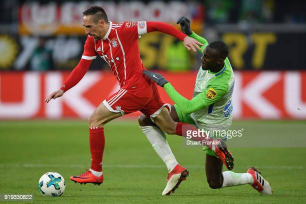 Franck Ribery of Bayern Muenchen l9 is chased by Joshua Guilavogui of Wolfsburg during the Bundesliga match between VfL Wolfsburg and FC Bayern...
