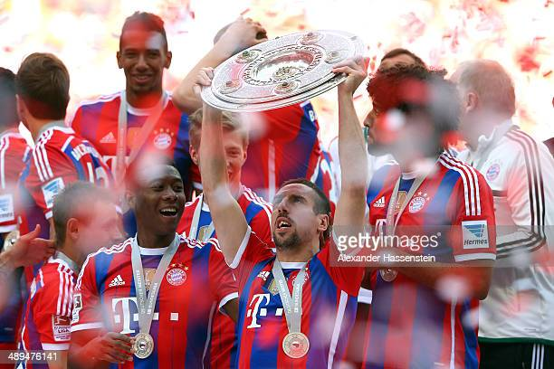 Franck Ribery of Bayern Muenchen lifts the Bundesliga championship trophy in celebration after the Bundesliga match between Bayern Muenchen and VfB...