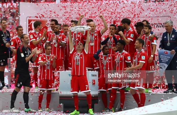Franck Ribery of Bayern Muenchen lifts the Championship trophy in celebration of the 67th German Championship title following the Bundesliga match...