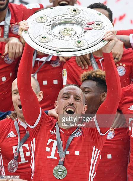 Franck Ribery of Bayern Muenchen lifts the Meisterschale as players and staffs celebrate the Bundesliga championship after the Bundesliga match...