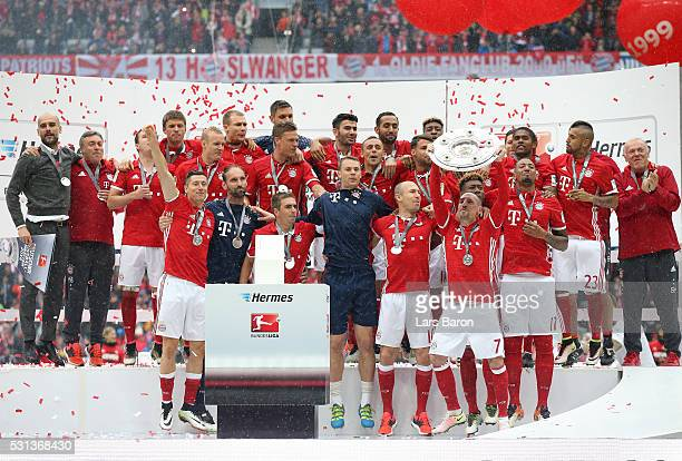 Franck Ribery of Bayern Muenchen lifts the trophy as he celebrates victory with team mates after the Bundesliga match between FC Bayern Muenchen and...