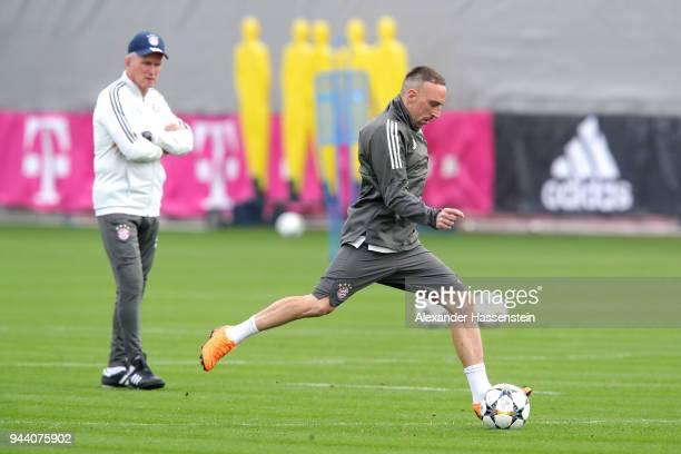 Franck Ribery of Bayern Muenchen plays with the ball as his head coach Jupp Heynckes looks on during a Bayern Muenchen training session ahead of the...