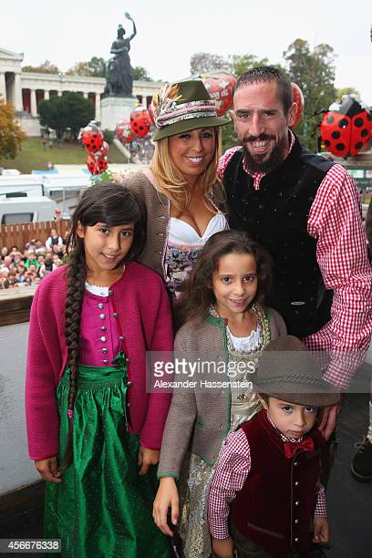 Franck Ribery of Bayern Muenchen poses with his wife Wahiba Belhami in front of the ensemble of the Bavaria statue a monumental bronze sandcast...