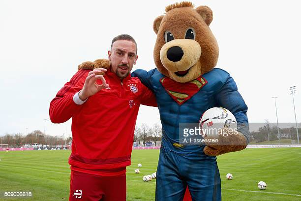 Franck Ribery of Bayern Muenchen poses with mascot Bernie dressed as Superman prior to a training session at Bayern Muenchen's training ground...