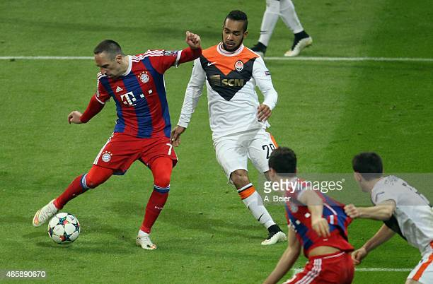 Franck Ribery of Bayern Muenchen scores his first goal against Alex Teixeira of Shakhtar Donetsk during the Champions League Round of 16 second leg...