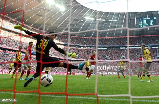 Franck Ribery of Bayern Muenchen scores his sides first goal past Roman Buerki of Borussia Dortmund during the Bundesliga match between Bayern...