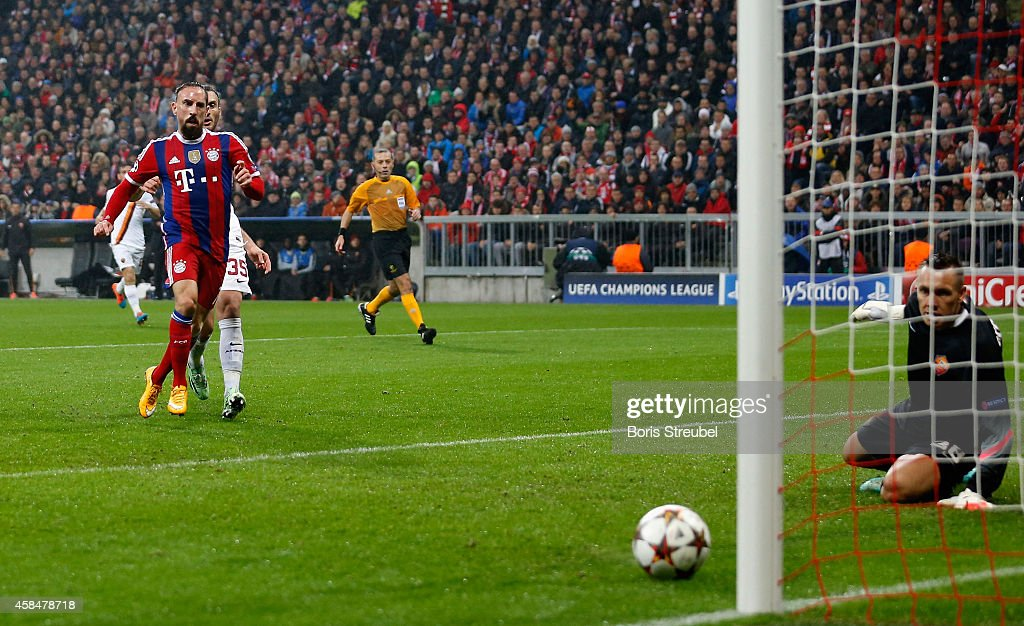 Franck Ribery (L) of Bayern Muenchen scores his team's first goal during the UEFA Champions League Group E match between FC Bayern Munchen and AS Roma at Allianz Arena on November 5, 2014 in Munich, Germany.