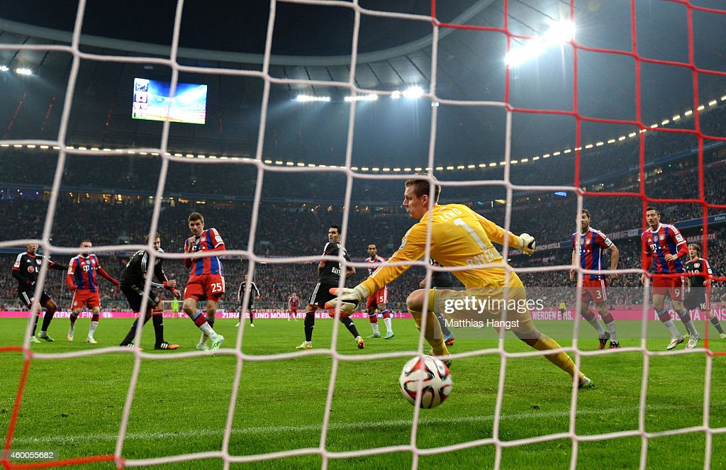 Franck Ribery (2nd L) of Bayern Muenchen scores the match winning goal past goalkeeper Bernd Leno of Bayer Leverkusen during the Bundesliga match between FC Bayern Muenchen and Bayer 04 Leverkusen at the Allianz Arena on December 6, 2014 in Munich, Germany.