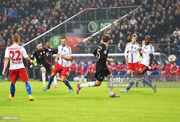 Franck Ribery of Bayern Muenchen scores the third goal during the DFB Cup match between Hamburger SV and FC Bayern Muenchen at Imtech Arena on...
