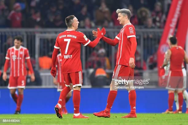 Franck Ribery of Bayern Muenchen shakes hands with Robert Lewandowski of Bayern Muenchen after the Bundesliga match between FC Bayern Muenchen and...