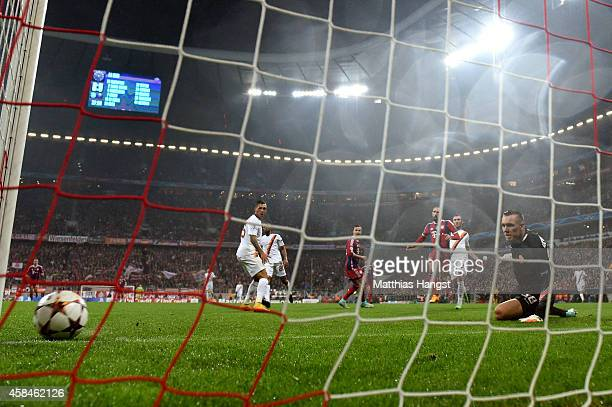 Franck Ribery of Bayern Muenchen shoots past goalkeeper Lukasz Skorupski of AS Roma to scoretheir first goal during the UEFA Champions League Group E...