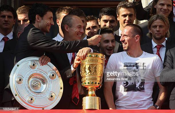 Franck Ribery of Bayern Muenchen smiles to Mark van Bommel and Arjen Robben after he confirmed to extend his contract until 2015 for Bayern Muenchen...