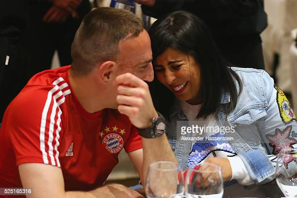 Franck Ribery of Bayern Muenchen smiles with his wife Wahiba during the Champions Banquette after the UEFA Champions League semi final first leg...