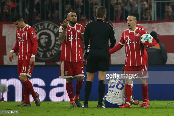 Franck Ribery of Bayern Muenchen speaks with Referee Tobias Stieler and Arturo Vidal of Bayern Muenchen during the Bundesliga match between FC Bayern...