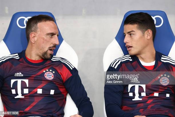 Franck Ribery of Bayern Muenchen talks with James Rodriguez of Bayern Muenchen on the bench during the Bundesliga match between TSG 1899 Hoffenheim...