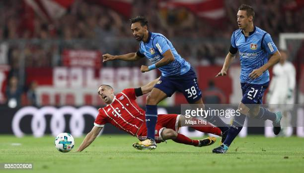 Franck Ribery of Bayern Muenchen with Benjamin Henrichs of Bayer Leverkusen and Karim Bellarabi of Bayer Leverkusen during the Bundesliga match...
