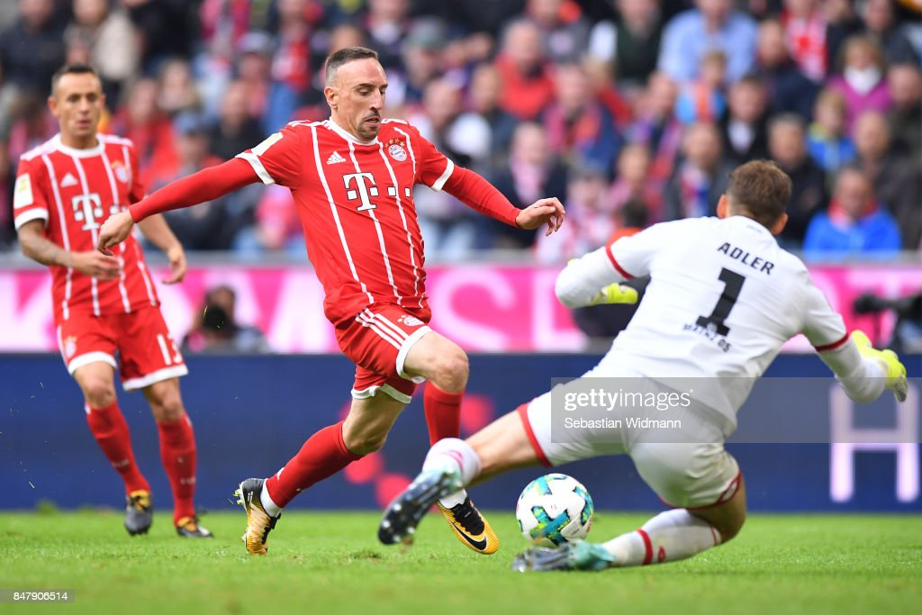 Franck Ribery of Bayern Muenchen (l) with goalkeeper Rene Adler of Mainz during the Bundesliga match between FC Bayern Muenchen and 1. FSV Mainz 05 at Allianz Arena on September 16, 2017 in Munich, Germany.