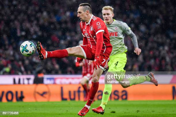 Franck Ribery of Bayern Munich and Frederik Sorensen of 1FC Koeln battle for the ball during the Bundesliga match between FC Bayern Muenchen and 1 FC...