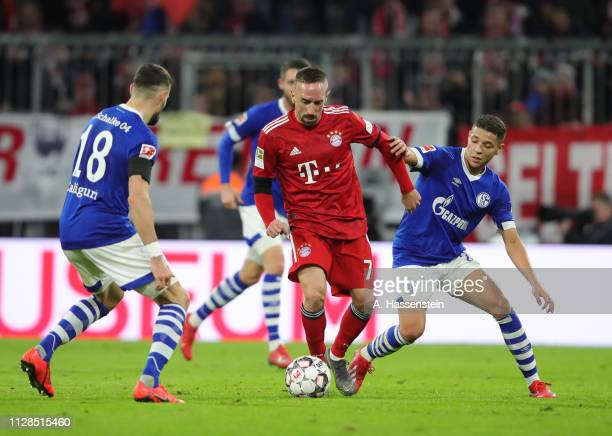 Franck Ribery of Bayern Munich battles with Daniel Caligiuri and Amine Harit of FC Schalke 04 during the Bundesliga match between FC Bayern Muenchen...