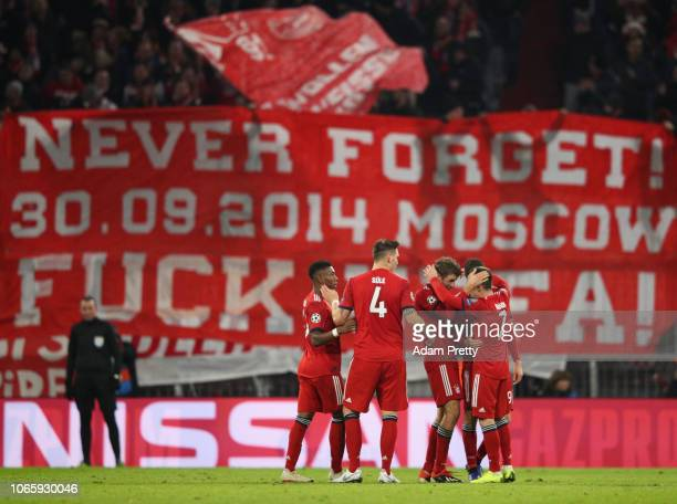 Franck Ribery of Bayern Munich celebrates after scoring his team's fifth goal in front of a protest banner with team mates during the UEFA Champions...