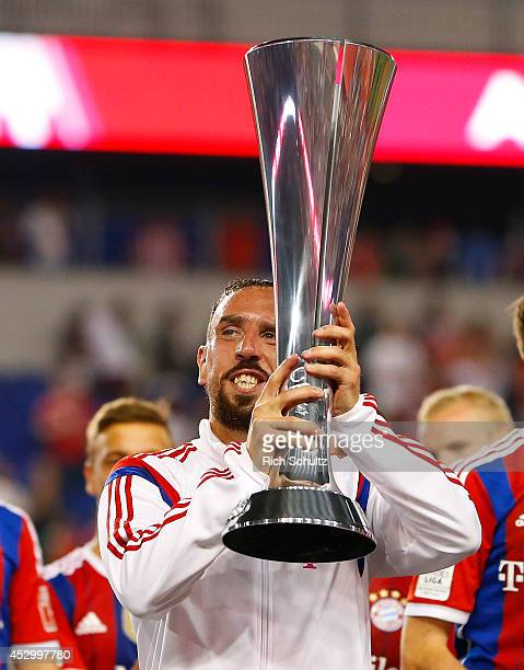 Franck Ribery of Bayern Munich holds the championship trophy after defeating Chivas 10 during a friendly match at Red Bull Arena on July 31 2014 in...