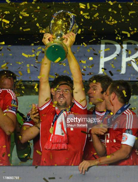 Franck Ribery of Bayern Munich lifts the trophy during the UEFA Super Cup between Bayern Muenchen and Chelsea at Stadion Eden on August 30 2013 in...