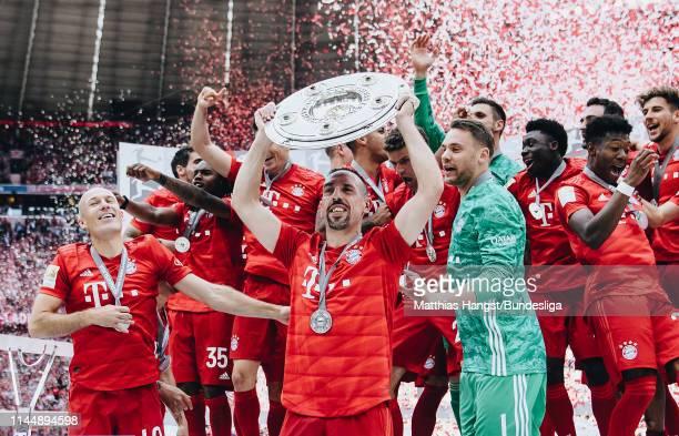 Franck Ribery of Bayern Munich lifts the trophy Meisterschale following the Bundesliga match between FC Bayern München and Eintracht Frankfurt at...