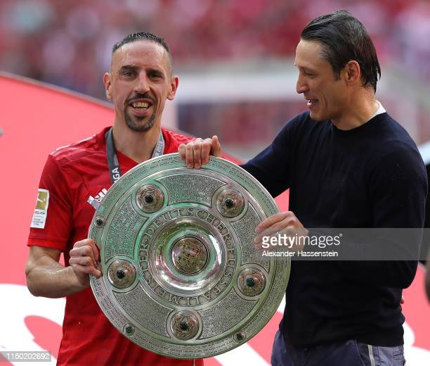 Franck Ribery of Bayern Munich poses with head coach Niko Kovac and the German championship trophy following the Bundesliga match between FC Bayern...