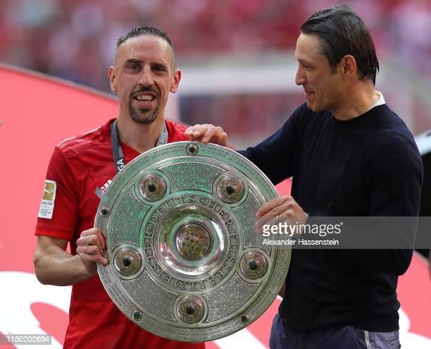 Franck Ribery of Bayern Munich poses with head coach Niko Kovac and the German championship trophy following the Bundesliga match between FC Bayern...