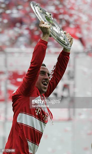 Franck Ribery of Bayern Munich runs away with the German Championship trophy after the Bundesliga match between FC Bayern Munich and Hertha BSC...