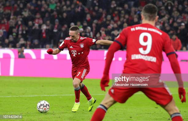 Franck Ribery of Bayern Munich scores his team's first goal during the Bundesliga match between FC Bayern Muenchen and RB Leipzig at Allianz Arena on...