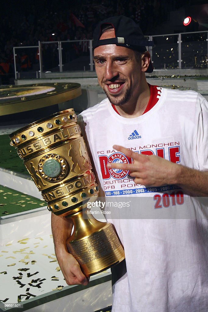 Franck Ribery of Bayern presents the trophy after winning the DFB Cup final match between SV Werder Bremen and FC Bayern Muenchen at Olympic Stadium on May 15, 2010 in Berlin, Germany.