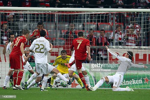 Franck Ribery of Bayern scores the first goal during the UEFA Champions League Semi Final first leg match between FC Bayern Muenchen and Real Madrid...