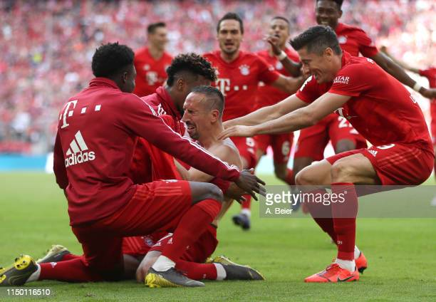 Franck Ribery of FC Bayern cries as he celebrates his goal with teammates Alphonso Davies and Robert Lewandowski during the Bundesliga match between...
