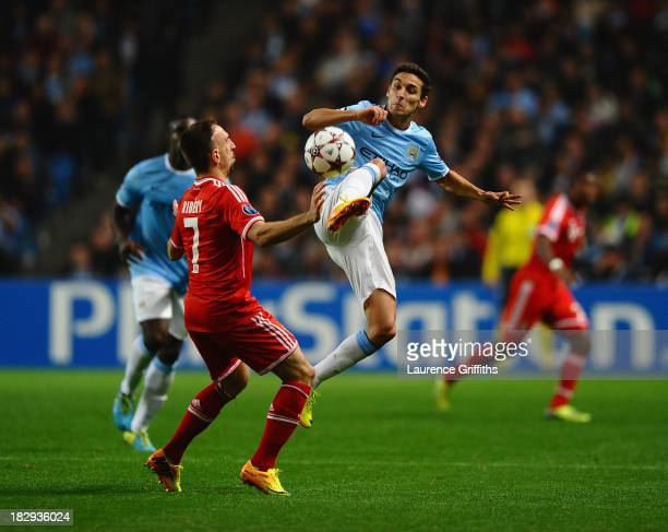 Franck Ribery of FC Bayern Meunchen battles with Jesus Navas of Manchester City during the UEFA Champions League Group D match between Manchester...