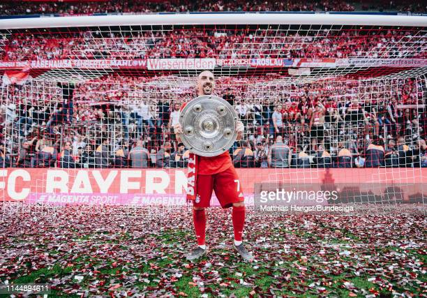 Franck Ribery of FC Bayern München celebrates with the trophy Meisterschale following during the Bundesliga match between FC Bayern München and...