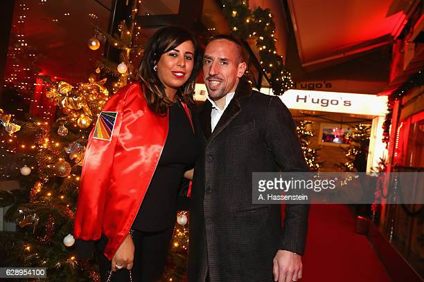 Franck Ribery of FC Bayern Muenchen and his wife Wahiba Ribery arrive for the club's Christmas party at H'ugo's bar on December 10 2016 in Munich...