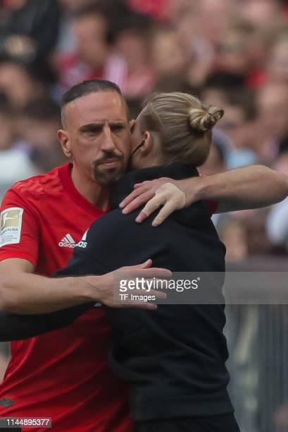 Franck Ribery of FC Bayern Muenchen and team manager Kathleen Krueger of FC Bayern Muenchen gesture during the Bundesliga match between FC Bayern...