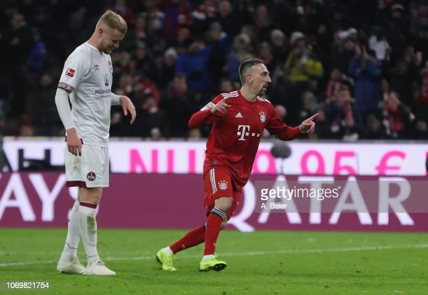 Franck Ribery of FC Bayern Muenchen celebrates his first goal next to Sebastian Kerk of 1. FC Nuernberg during the Bundesliga match between FC Bayern...