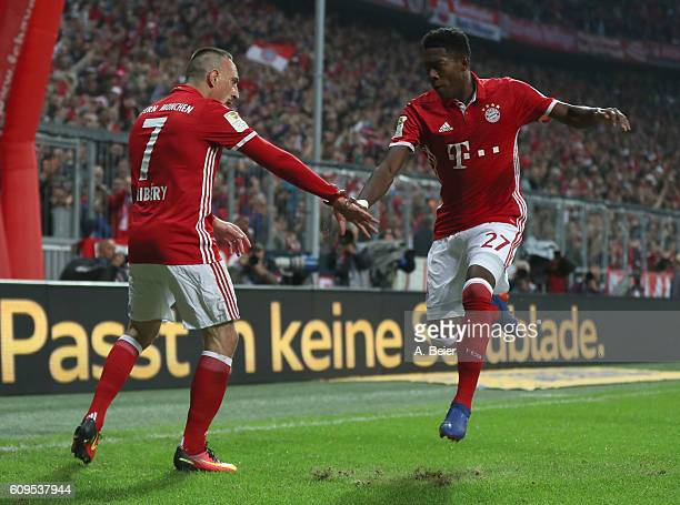 Franck Ribery of FC Bayern Muenchen celebrates his first goal with teammate David Alaba during the Bundesliga match between Bayern Muenchen and...