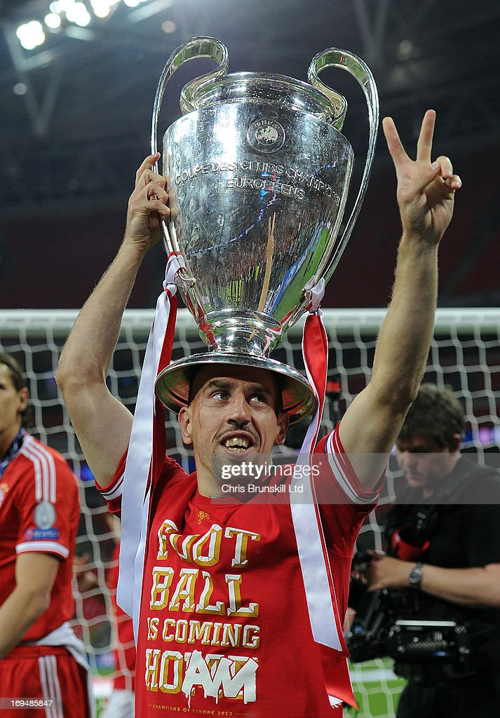 Franck Ribery of FC Bayern Muenchen celebrates with the trophy following the UEFA Champions League final match between Borussia Dortmund and FC Bayern Muenchen at Wembley Stadium on May 25, 2013 in London, England.