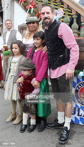 Franck Ribery of FC Bayern Muenchen his wife Wahiba Ribery and their children attend the Oktoberfest 2014 beer festival at Kaefers Wiesenschaenke at...