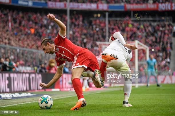 Franck Ribery of FC Bayern Muenchen is challenged by Gotoku Sakai of Hamburg during the Bundesliga match between FC Bayern Muenchen and Hamburger SV...