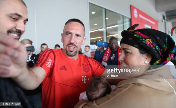 Franck Ribery of FC Bayern Muenchen is welcomed by wife Wahiba and family and friends during his arrival for the Bundesliga match between FC Bayern...