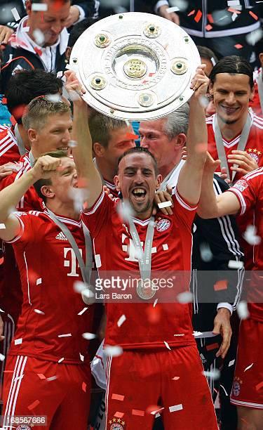 Franck Ribery of FC Bayern Muenchen lifts the Bundesliga trophy after the Bundesliga match between FC Bayern Muenchen and FC Augsburg at the Allianz...