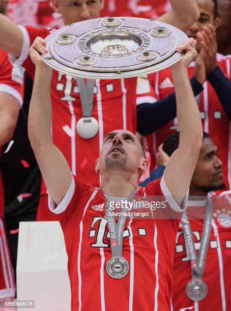 Franck Ribery of FC Bayern Muenchen lifts the Championship trophy in celebration of the 67th German Championship title following the Bundesliga match...