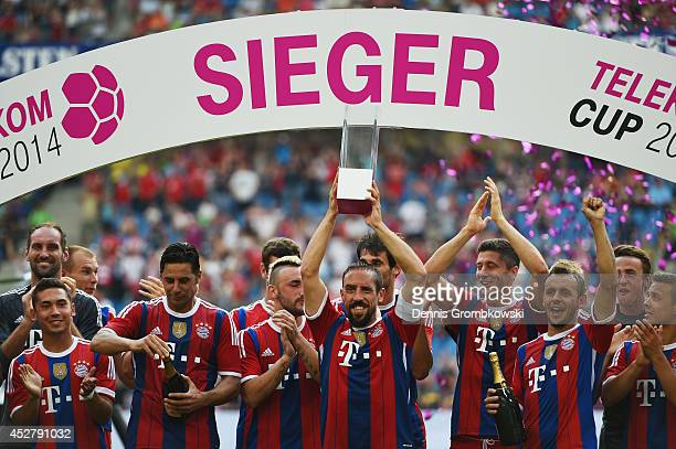 Franck Ribery of FC Bayern Muenchen lifts the trophy after the Telekom Cup 2014 final match between FC Bayern Muenchen and VfL Wolfsburg at Imtech...