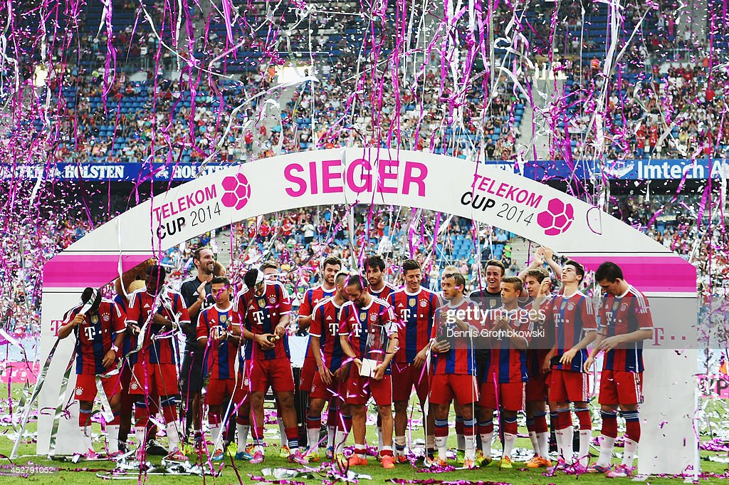 Franck Ribery of FC Bayern Muenchen lifts the trophy after the Telekom Cup 2014 final match between FC Bayern Muenchen and VfL Wolfsburg at Imtech Arena on July 27, 2014 in Hamburg, Germany.