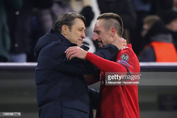 Franck Ribery of FC Bayern Muenchen shake hands with his head coach Niko Kovac after his substitution during the Group E match of the UEFA Champions...